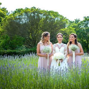 bride with bridesmaids in lavendar