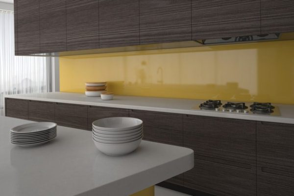 Kitchen with yellow splashback