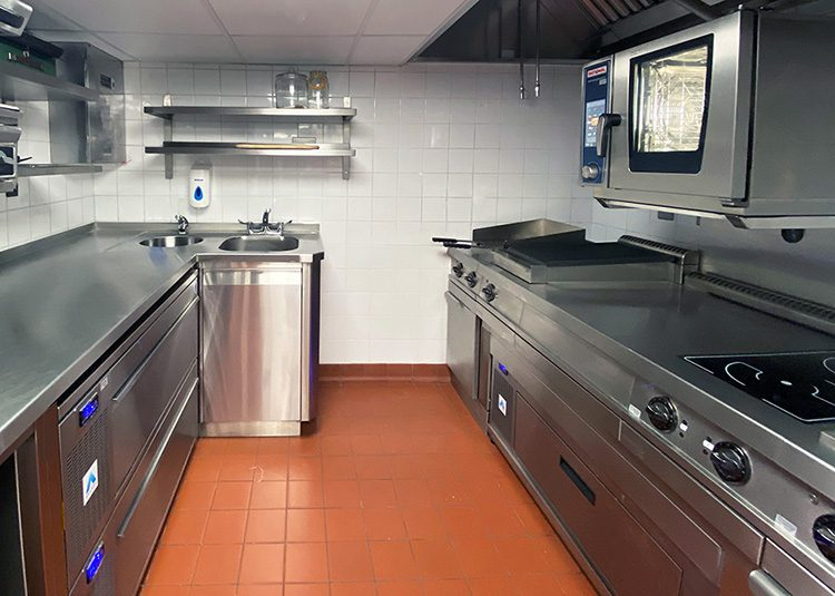 Confined, small kitchen at The Dorchester Bar Kitchen