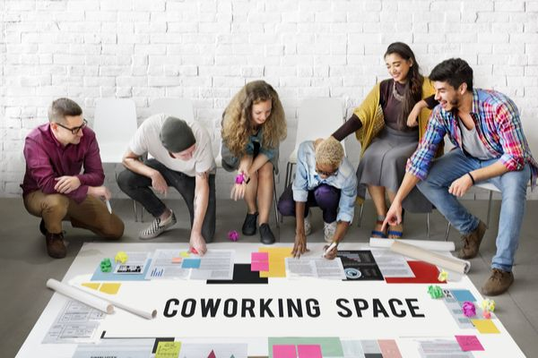 coworking space, employees in group discussion
