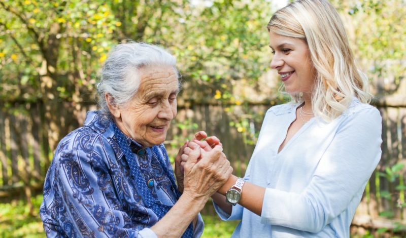 female home carer with elder woman