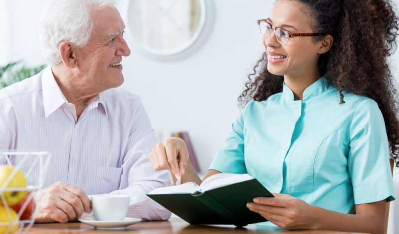 support female care worker with elder male patient