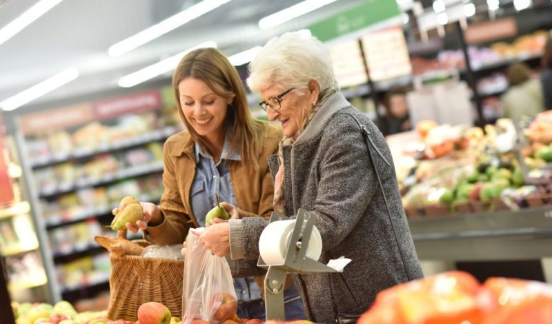 out and about female carer shopping with patient